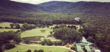 Aerial image of Cave Hill Creek camp and surrounds from a hot air balloon in the sky