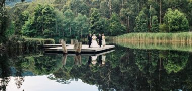 Wedding couple standing at Cave Hill Creek waterfront