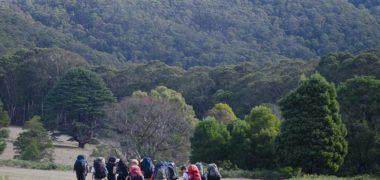 Group of people wearing overnight hiking backpacks doing the Beeripmo walk